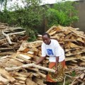 Dorothy Kabajungu, 50, has started a firewood business after obtaining a loan from a women's bank. Credit:Wambi Michael