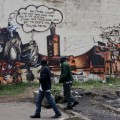 Boniface Mwangi organised a group of graffiti artists to create controversial murals around Nairobi depicting the nations political elite as vultures and criticising the populace for voting them into office again and again. Credit: Mike Elkin/IPS