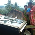 Forest women in Anantagiri forest in the south-east of India check out their solar dryer. Credit: Stella Paul/IPS.