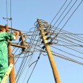 A man repairs an electricity pylon in Somaliland. Credit: IPS
