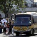 Passengers board a bus belonging to an urban transport cooperative that runs several routes between different Havana neighbourhoods. Credit: Jorge Luis Baños/IPS